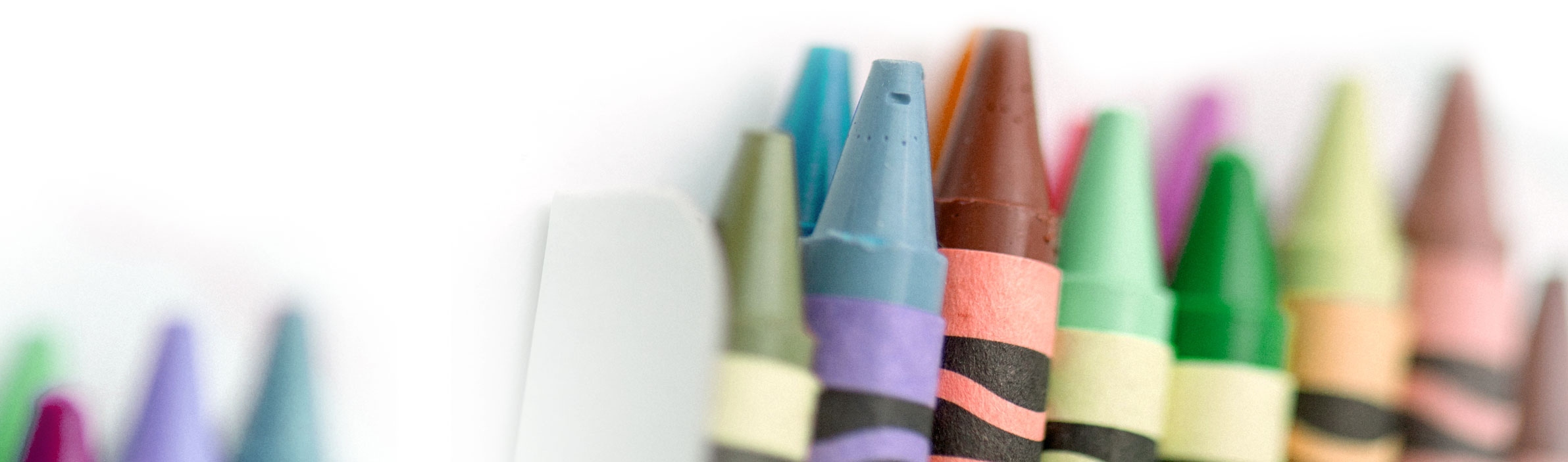 crayons in holder on white background